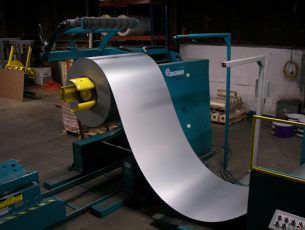 Steel coil being removed from the press