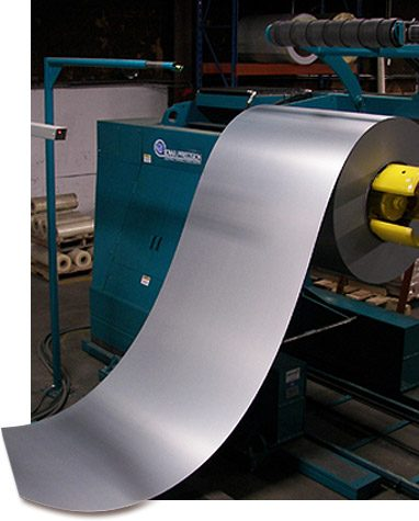 Aluminum sheet metal coil coming off of the press machine